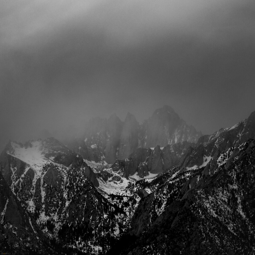 Black and white image of Mount Whitney in the coming, late winter storm